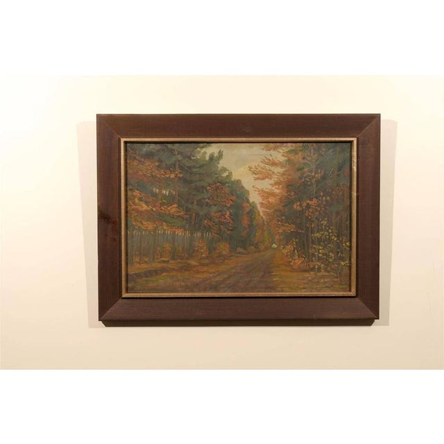 Early 20th-century Dutch oil on canvas in the Impressionist style of a dirt road flanked by trees in autumn showing the...