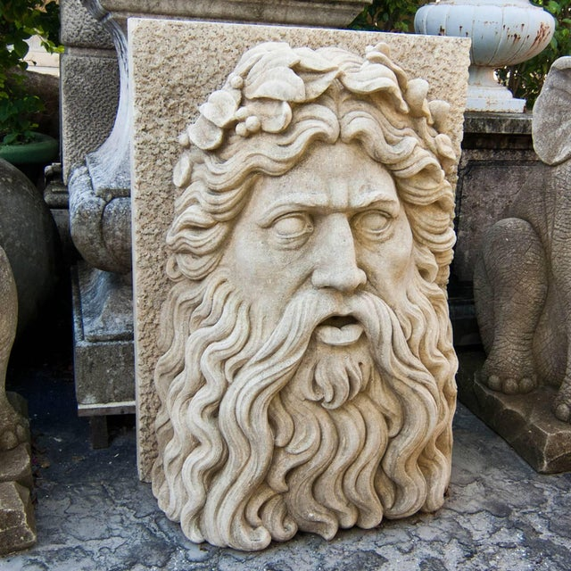 Tall Renaissance style large limestone mask, early 20th century, Italy depicting Zeus in a half relief. Detailed hand-...