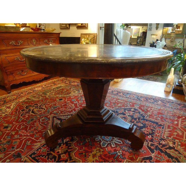 Stunning early 19th century French Bourbon Restoration or Restauration period walnut pedestal center table with original...