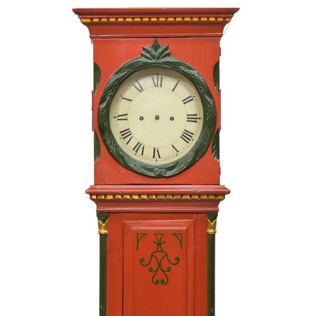 Wonderful painted Danish Empire Bornholm grandfather clock from the 19th c.. It features a painted and gilt pine tall...