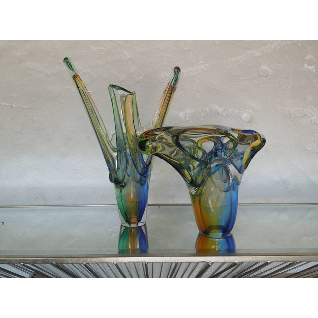 This is a gorgeous piece of handblown glass signed by the artist, A. Jablanski. The colors of green, amber and blue...