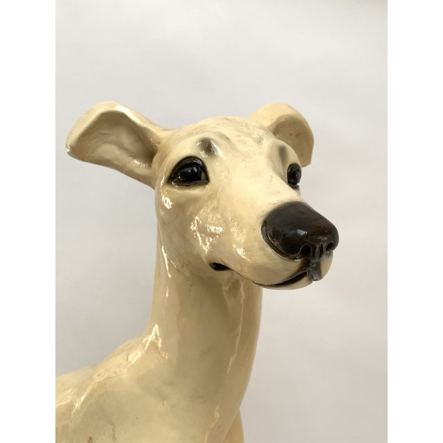 This sweet and elegant sitting greyhound sculpture was produced by LA company Designer Repros, ca. 1950s/1960s and is in...