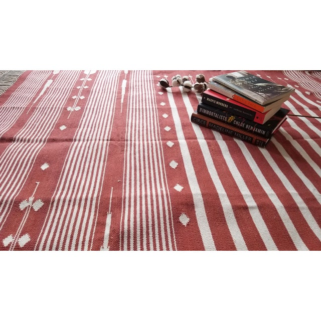 This is a beautiful handwoven rug, traditionally used as floor coverings in India. Meticulously woven on traditional...