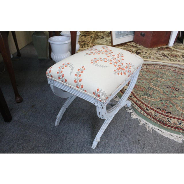 Single floral upholstered stool of white textile with orange flowers on light blue painted wood base. Perfect for the...