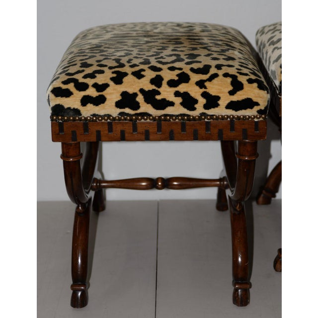 Pair of William Switzer Carved Curule Benches Carved Beechwood with a rich Georgian Walnut finish and ebony trim. The...
