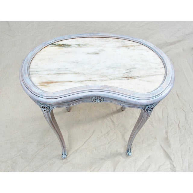 French kidney shape striated marble top table with carved wood frame, exquisitely lithe cabriole legs, and scalloped...