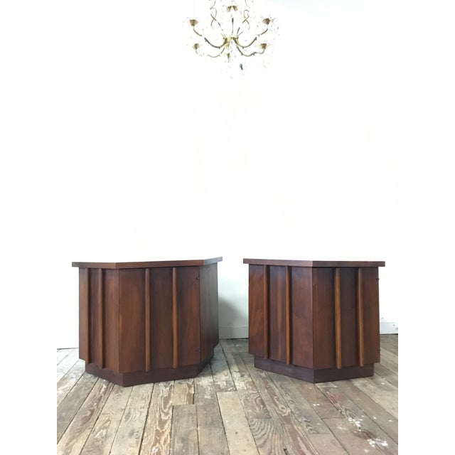 A stunning and unusual pair of hexagon shaped walnut end tables by Lane. These would work great in a living room or as...