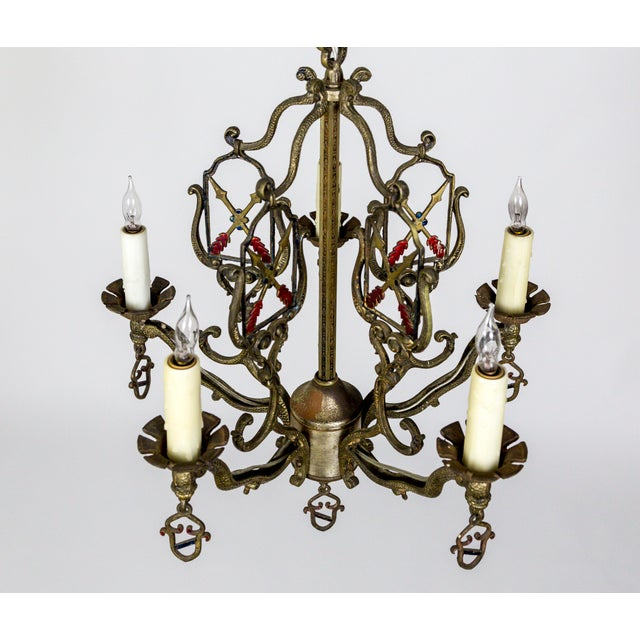 A Medieval Revival, American 1920, painted metal chandelier. This was a popular style for the entry of apartments at that...