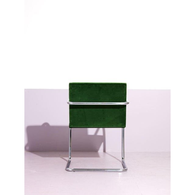 Mies Van Der Rohe tube chrome cantilever side chair reupholstered in deep green cotton velvet. Available for reupholstery...