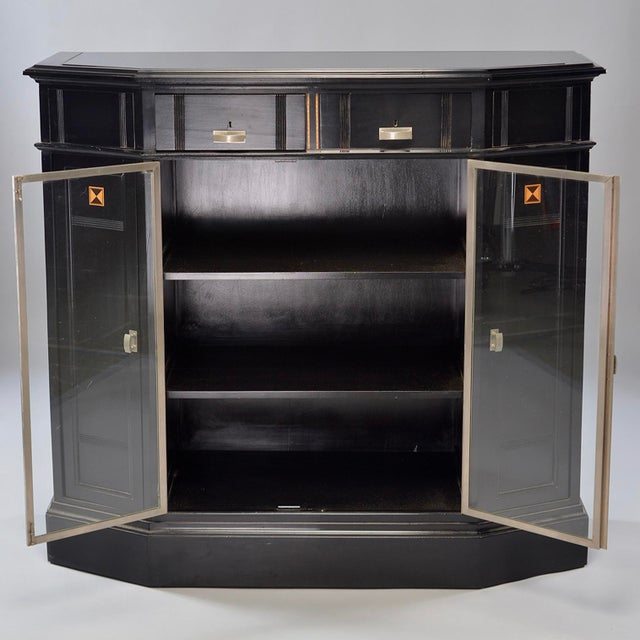 Art Deco cabinet found in Belgium, circa 1930s. New ebonized finish with lower center glass front doors, decorative...