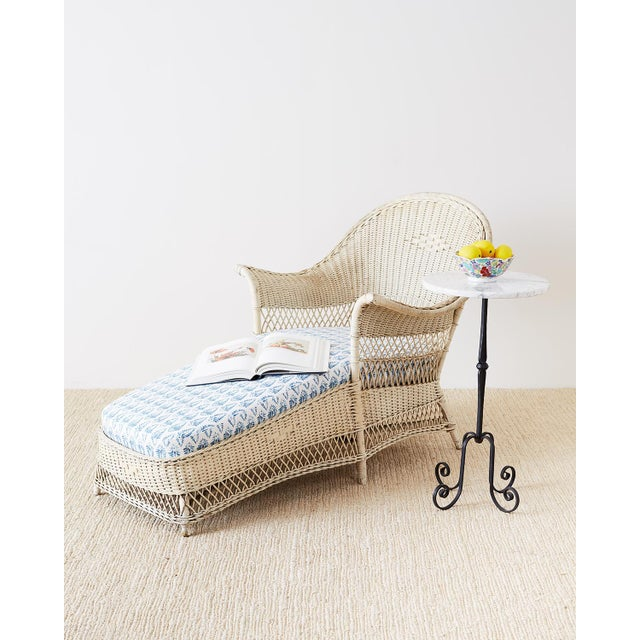 Attractive Bar Harbor style willow and wicker chaise lounge or lounge featuring a vintage painted finish. The sculptural...