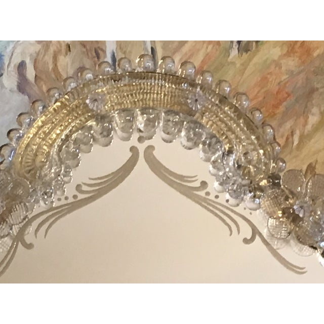 Made in Italy sometime in 1940s - 1960s. Set with detailed glass florets surrounding the frame , this Mirror is very...