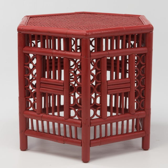 Boho Chic or Chinoiserie hexagonal bamboo coffee table in a spicy red finish. The frame is constructed using pieces of...