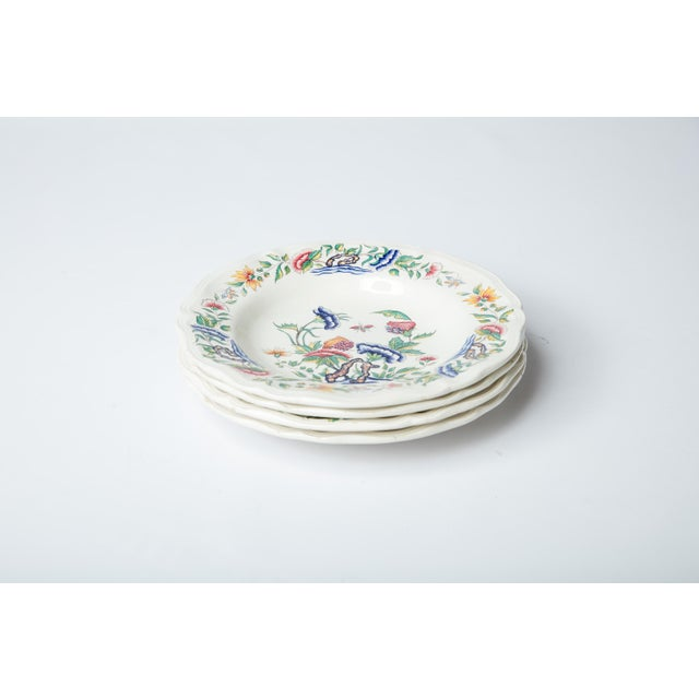 A set of four vintage Madcap Cottage Chinoiserie-style brightly colored ceramic floral soup bowls. Made in France by...