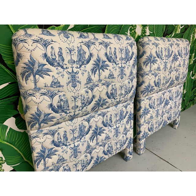 Pair of twin headboards upholstered in blue and white Asian chinoiserie style fabric featuring palm trees, pagodas, and...