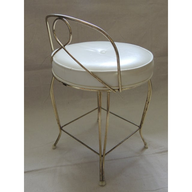 Vintage Art Deco style vanity stool with round cushion. Original faux leather seat cushion with tufted button in white....