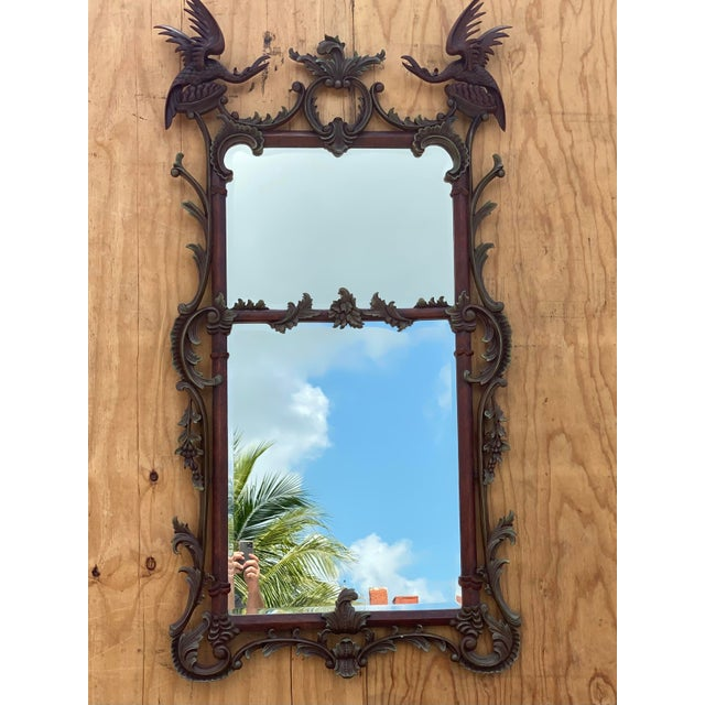 Exception vintage Chinoiserie mirror. Beautiful delicate birds crown this fantastic frame. Gesso over wood in dark brown...