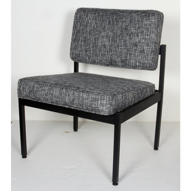 Mid-century modern industrial style chairs with streamline design and floating seat and back cushions. Fine example of...