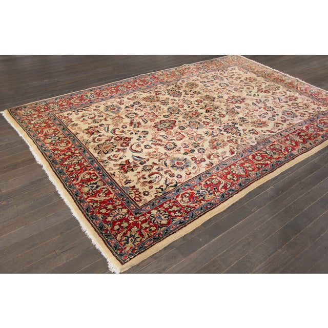 A vintage hand-knotted Persian rug with an allover design on a beige field, this rug has pristine detail and is ready for...