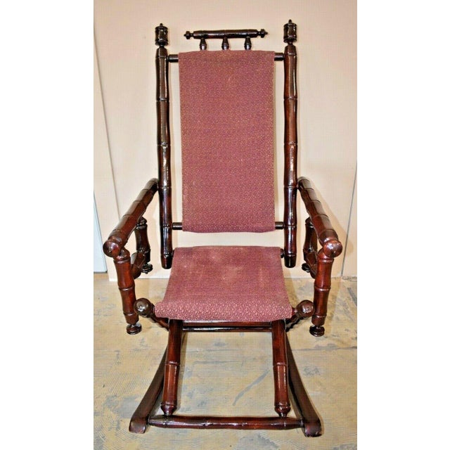 Vintage Faux Bamboo Rocking Chair with Mahogany Finish and Maroon Upholstery Very comfortable with gloss finish....