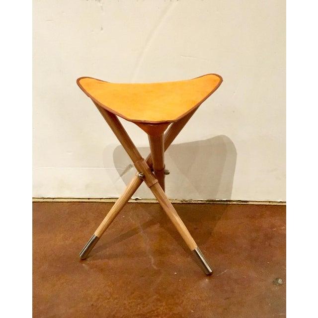 Global Views elegant camp stool hair on orange, light wood base with solver ferrules, showroom floor sample.