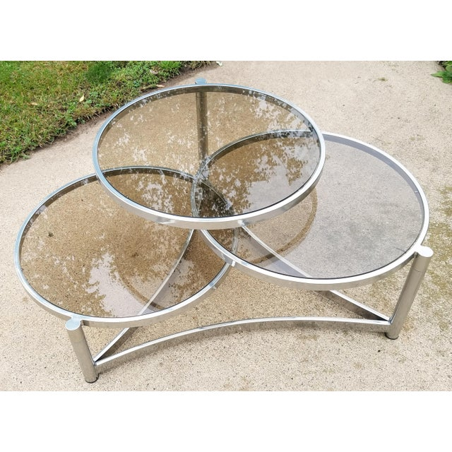 Beautiful mid century modern tri level chrome and glass swivel coffee table with lightly smoked glass coffee table with...