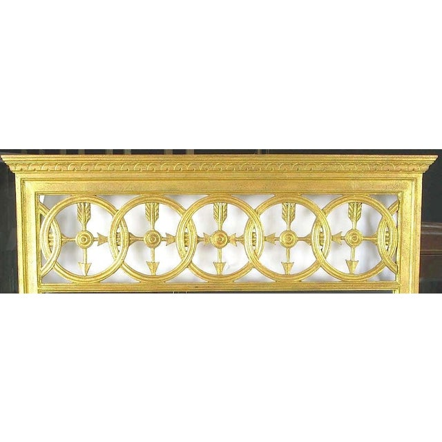 A fine and well executed example of Italian Empire design. Open transom featuring interlocking circles and crossed arrows....