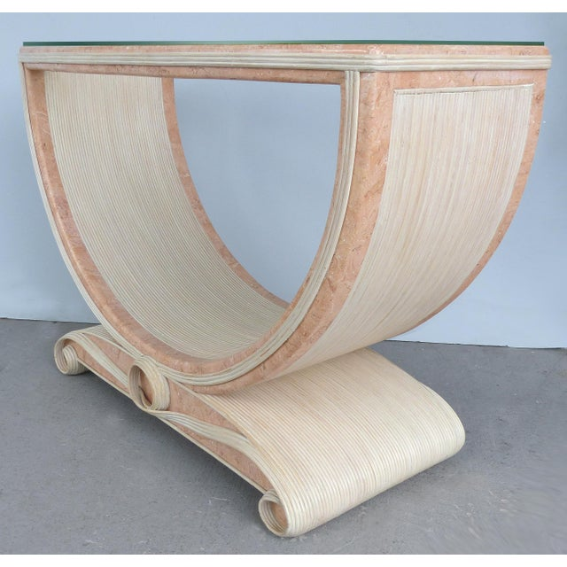 Offered for sale is a reeded and faux painted marble console table in the style of Gabriella Crespi. The faux marble...