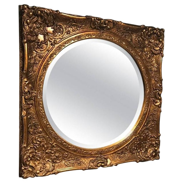 Giltwood Mirror with Ornate Details For Sale