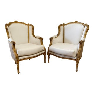 Pair of Vintage Louis XVI Style Wing Back Bergère Chairs For Sale