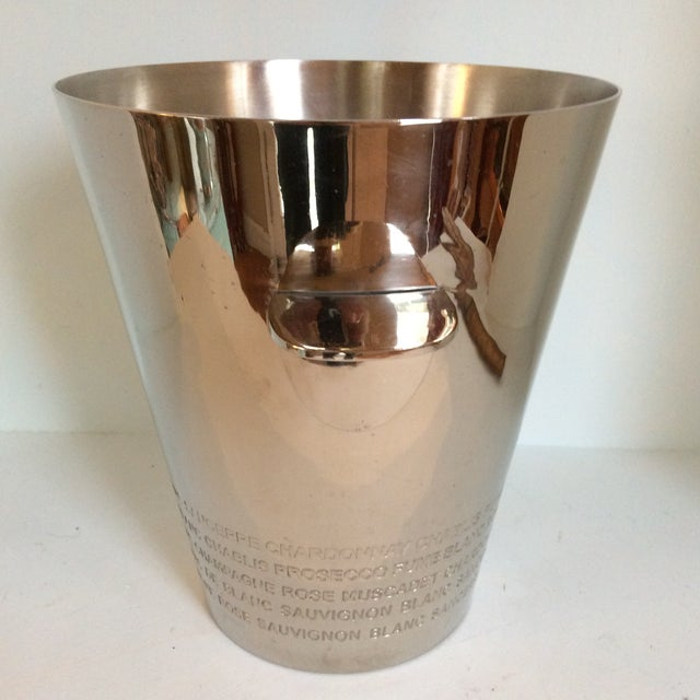 Super nice chrome plated white wine bottle cooler with various white wine names engraved around base. Wine names like...