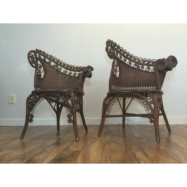 Pair of Victorian wicker photographers chairs from the 1890s. They feature asymetric backs and distinctive curled wick...
