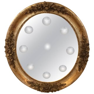 Glamorous Ornate French Giltwood and Bullseye Mirror For Sale