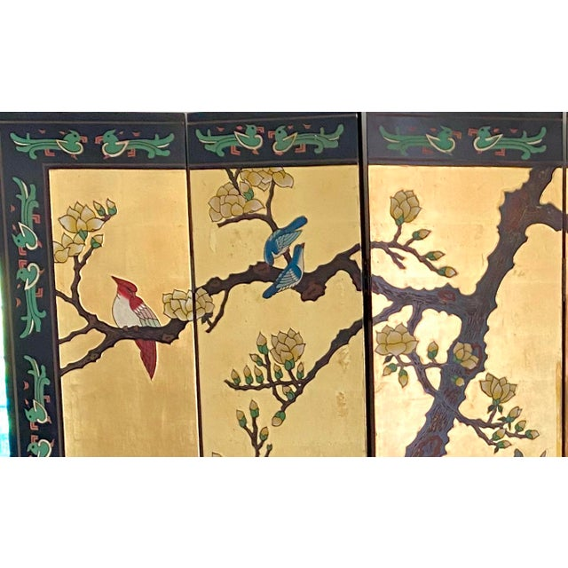 Vintage six panel, double sided, Chinese coromandel girl and lacquer screen with brass feet and joints. The glorious gilt...