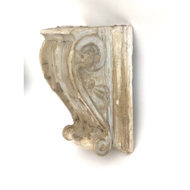 Original antique cast plaster corbel sourced in France with holes for hanging. Could also be used as a table top display.