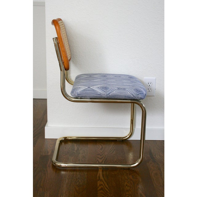 Set of four (4) vintage Marcel Breuer Style cantilever chairs. New cane backing, upholstered seats and brass legs. These...