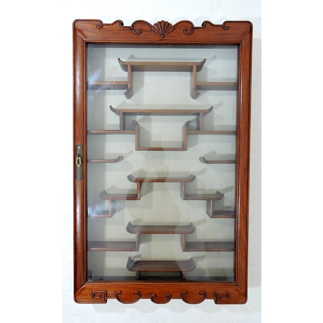 Ming style Chinese curio or wall display cabinet made from solid rosewood. Simple and elegant in style, all wood...