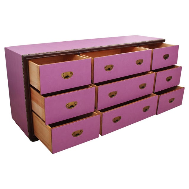 Drexel chest of drawers wrapped in faux leather. This dresser features solid wood, nine dovetailed drawers in great...