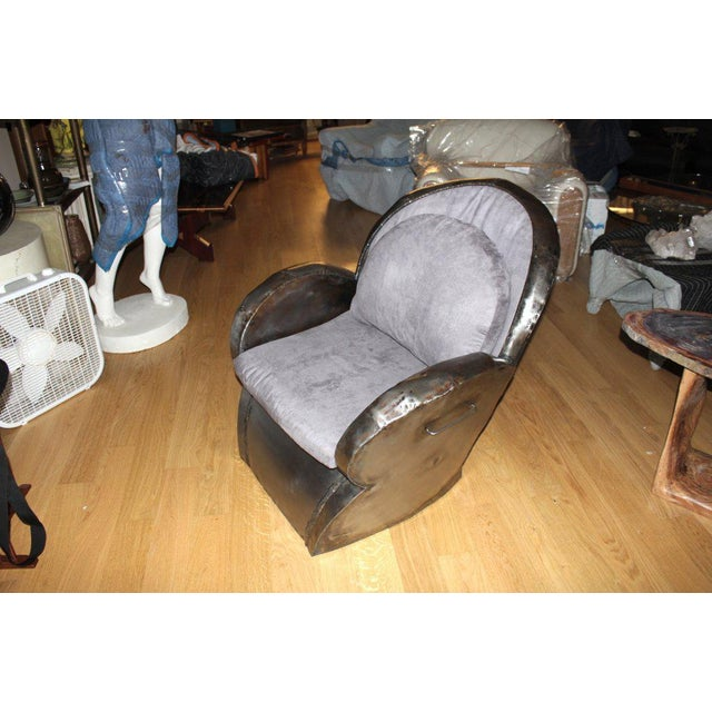 An unusual handmade and welded steel chair in new upholstery. This chair was thought to have been sold at auction as part...
