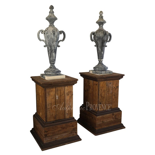 Mid-19th century, a pair of slender lidded zinc finials from France with graceful four handles and topped with a sphere....
