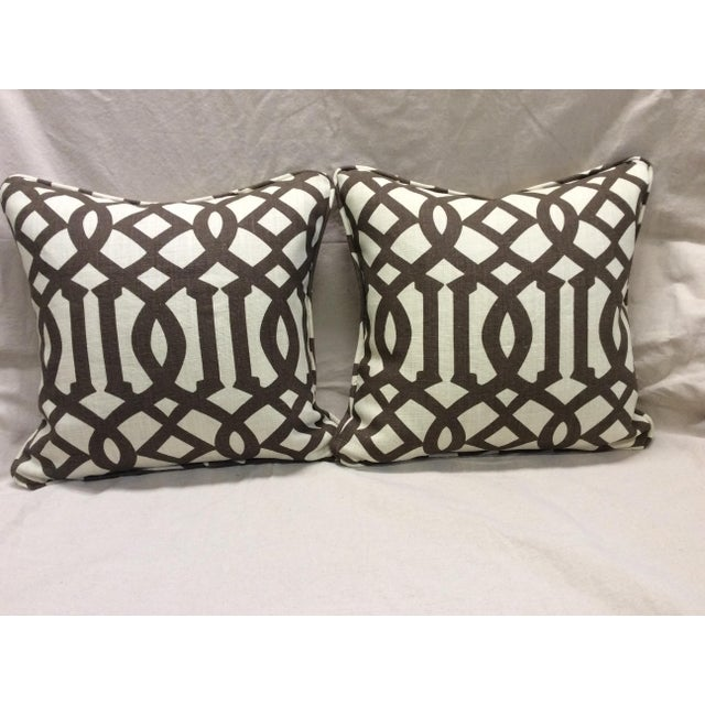 A pair of new custom made pillows in brown and neutral. The fabric is cotton with a stiff feel to it that helps hold its...