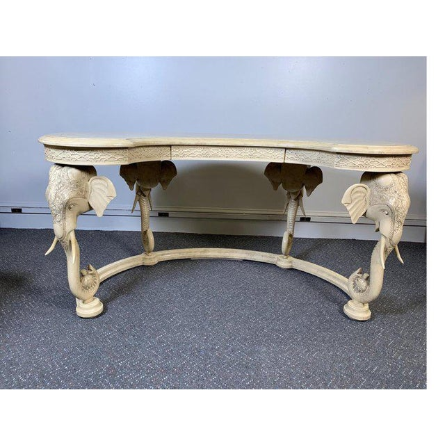 Hollywood Regency kidney desk with chair by Gampel Stoll. The ivory faux painted goatskin lacquered finish on both the...