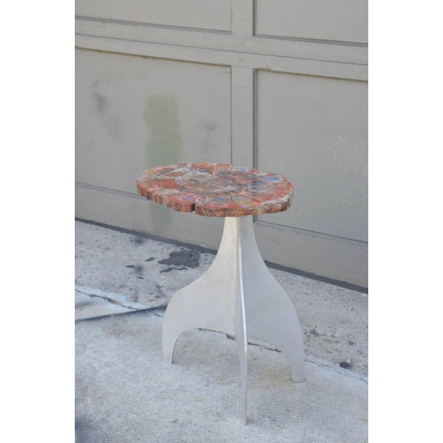 Seve' petrified wood and aluminium side table by Design Frères.