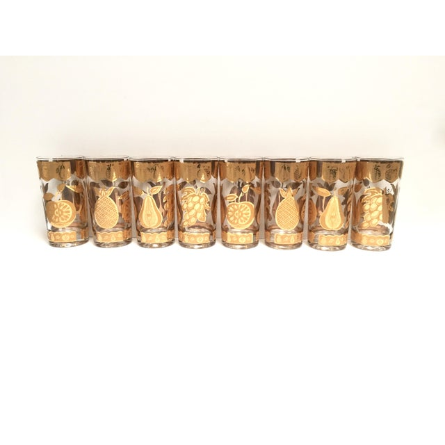 This sparkly set of 8 vintage tumblers features different fruit -- pineapples, grapes, pears and apples -- applied in 22k...