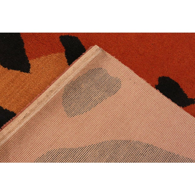 A Paul Klee artist rug with vivid warm colors, made in the Netherlands.