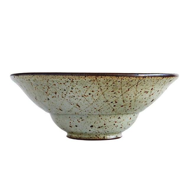 California studio potter and influential teacher Antonio Prieto threw this stoneware bowl with a two-stage profile, and...