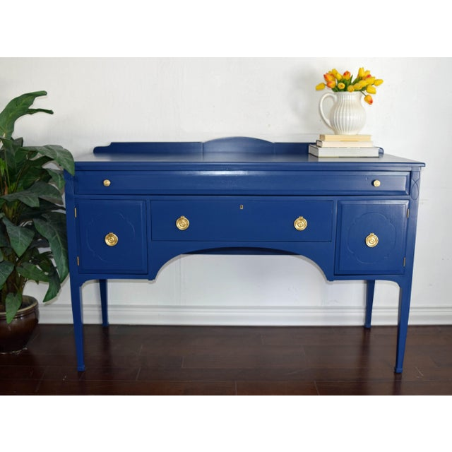 Antique Cherrywood navy blue sideboard. Refinished in Inked by BEHR. Handles were painted in gold. Use it as a TV stand,...
