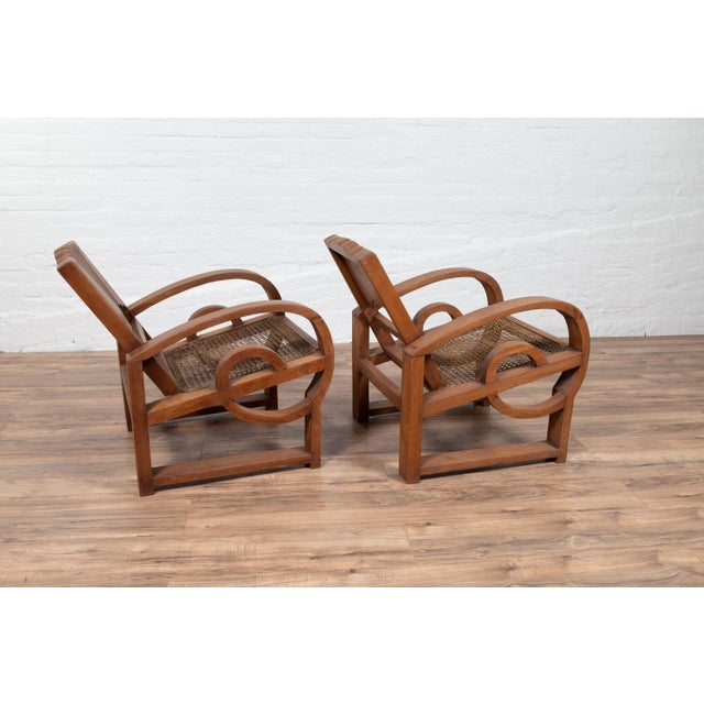 Rustic Teak Wood Country Chairs From Madura With Rattan Seats and Looping Arms - a Pair For Sale - Image 3 of 13