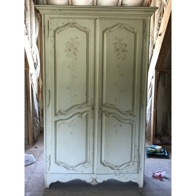Ethan Allen armoire painted with floral motif French country collection.
