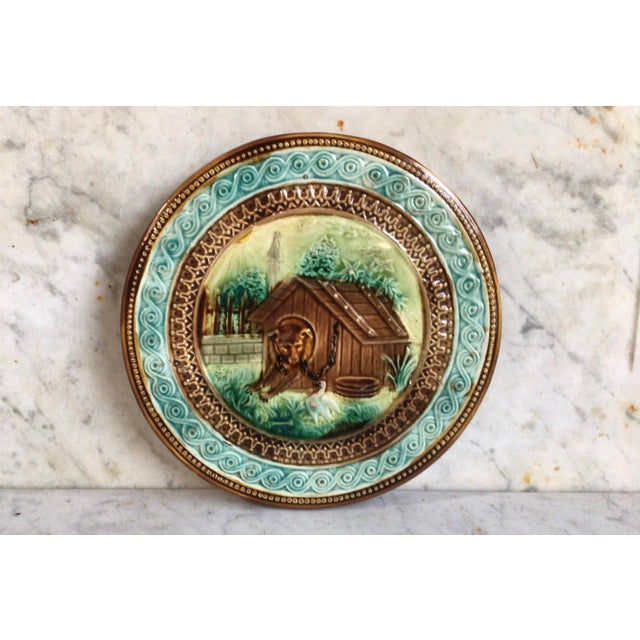 French Majolica Dog in a kennel Trivet Onnaing Circa 1890.